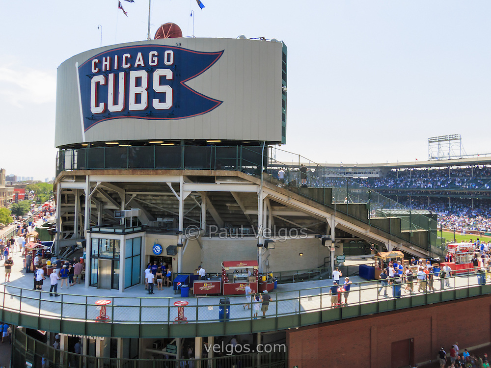 Photo of Wrigley Field and Chicago Cubs sign in Chicago. Wrigley Field is a Chicago landmark baseball field that was built in 1914 and is home to the Chicago Cubs Major League Baseball team.  Photo was taken in 2012.