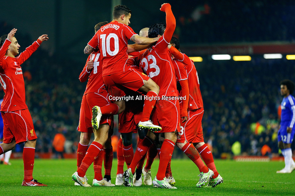 20.01.2015.  Anfield, Liverpool, England. Capital One Cup Semi Final. Liverpool versus Chelsea. Liverpool midfielder Raheem Sterling celebrates scoring his teams goal (1-1)with team mates