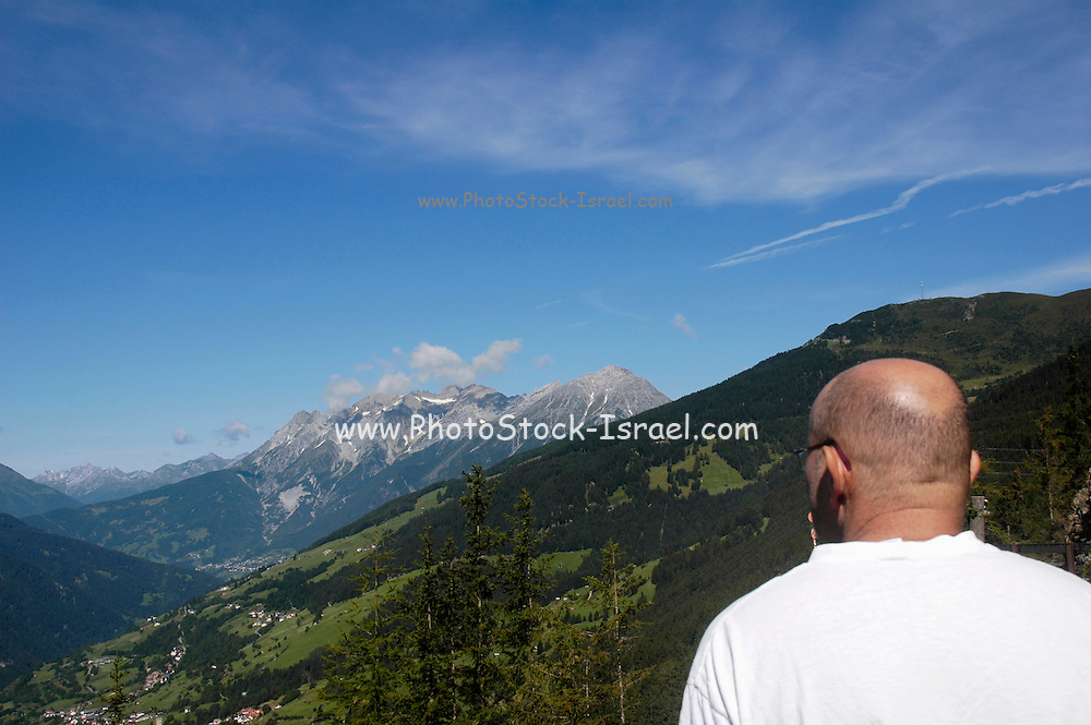 Austria, Tyrol, Landeck District, Kaunertal valley, overlooking Jerzens im Pitztal tourists admiring the view. Model release available