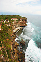 Waves crashing onto the shore of the Ulawati coastline, Bali, Indonesia.