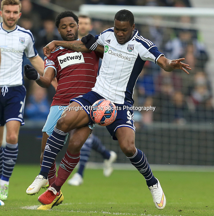 14th February 2015 - FA Cup 5th Round - West Bromwich Albion v West Ham United - Brown Ideye of West Bromwich Albion tustles with Alex Song of West Ham United  - Photo: Paul Roberts / Offside.