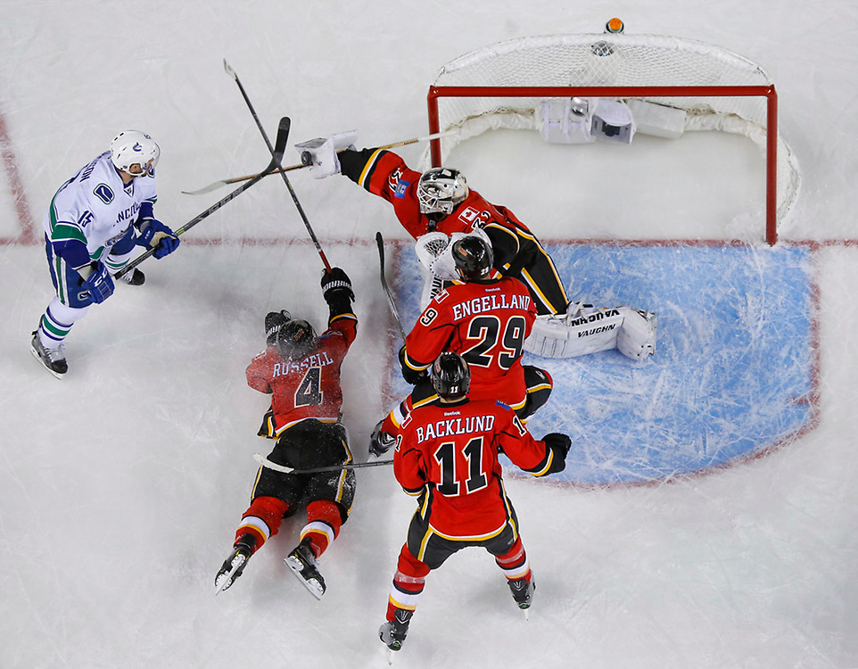 Karri Ramo #31 of Calgary Flames makes a blocker save against the Vancouver Canucks in round 1 game 6 of the Stanley Cup Playoffs at Scotiabank Saddledome on April 25, 2015 in Calgary, Alberta, Canada. (Photo by Jenn Pierce/NHLI via Getty Images)