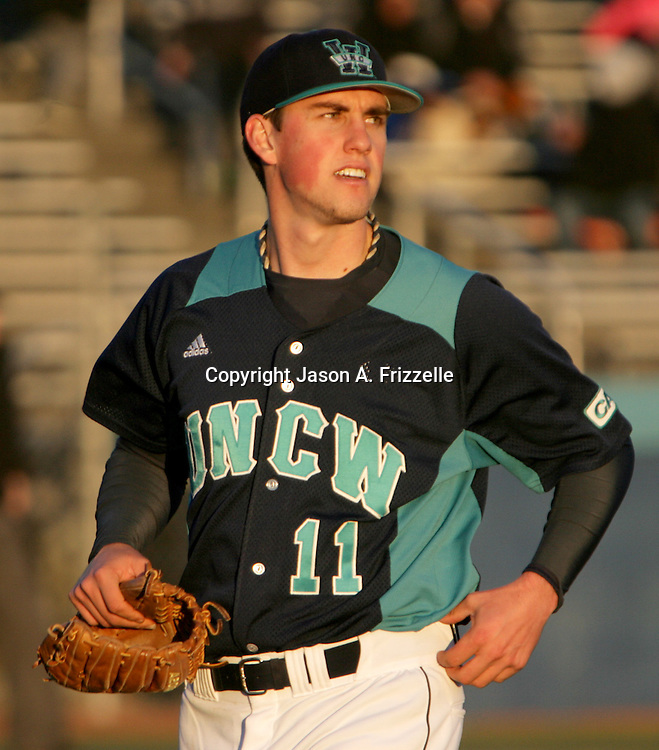 The University of North Carolina at Wilmington's Jordan Ramsey takes a final look at the scoreboard as he leaves the field after being relieved Saturday February 15, 2014 during the second day of the Hughes Brothers Challenge at Brooks Field in Wilmington, N.C. The University of Kentucky faced the University of North Carolina at Wilmington on the second day of the Hughes Brothers Challenge Saturday February 15, 2014 at Brooks Field on the campus of the University of North Carolina at Wilmington in Wilmington, N.C. (Jason A. Frizzelle)