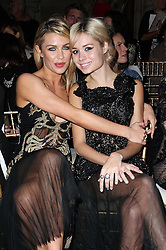 Abbey Clancy and Nina Nesbitt in the front row at the Julien Macdonald show at London Fashion Week Autumn/Winter 2014/15 Saturday, 15th February 2014. Picture by Stephen Lock / i-Images