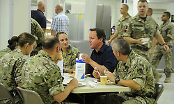 STRICT EMBARGO UNTIL 1800HRS 04 JULY 2011© Licensed to London News Pictures. 04/07/2011. British Prime Minister David Cameron shares breakfast with British solderis in Camp Bastion, Afghanistan today (4 Jul 11). See special instructions. Mandatory Photo credit : Sergeant Alison Baskerville/LNP