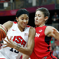 07 August 2012: USA Candace Parker drives past Canada Natalie Achonwa during 91-48 Team USA victory over Team Canada, during the women's basketball quarter-finals, at the Basketball Arena, in London, Great Britain.