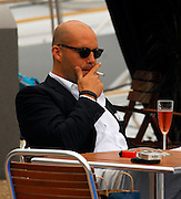 20.MAY.2008. CANNES<br /> <br /> BILLY ZANE STEPS OFF A YACHT IN CANNES TO HAVE A CIGARETTE AND A GLASS OF CHAMPAGNE WITH A FRIEND.<br /> <br /> BYLINE: EDBIMAGEARCHIVE.CO.UK<br /> <br /> *THIS IMAGE IS STRICTLY FOR UK NEWSPAPERS AND MAGAZINES ONLY*<br /> *FOR WORLD WIDE SALES AND WEB USE PLEASE CONTACT EDBIMAGEARCHIVE - 0208 954 5968*