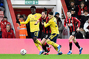 Dan Gosling (4) of AFC Bournemouth is crowded out by Bukayo Saka (77) of Arsenal and Gabriel Martinelli (35) of Arsenal during the The FA Cup match between Bournemouth and Arsenal at the Vitality Stadium, Bournemouth, England on 27 January 2020.