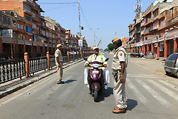 September 10, 2017 - Jaipur, Rajasthan, India - Police patrol streets as curfew was imposed in parts of Jaipur after late-night violence between locals and police, triggered by an alleged assault on a woman by the cops, in Jaipur ,Rajasthan, India. 10 Sept,2017. (Credit Image: © Vishal Bhatnagar/NurPhoto via ZUMA Press)