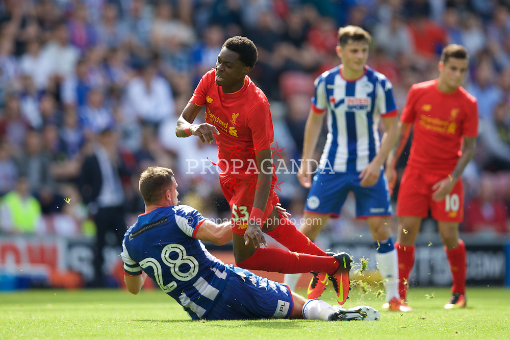 WIGAN, ENGLAND - Sunday, July 17, 2016: Liverpool's Oviemuno Ejaria is tackled by Wigan Athletic's captain Jason Pearce during a pre-season friendly match at the DW Stadium. (Pic by David Rawcliffe/Propaganda)