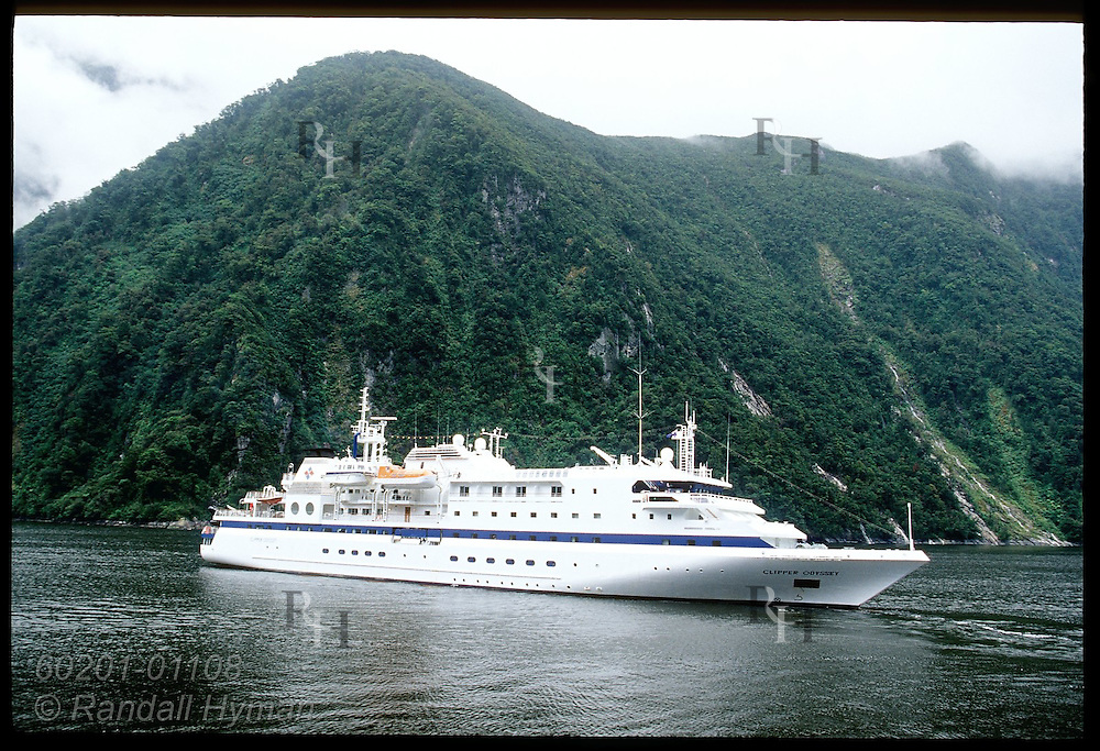 Cruise ship Clipper Odyssey moors in Milford Sound; Fiordland National Park, New Zealand.