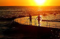 SYDNEY, AUSTRALIA - JANUARY 08:  Sunrise swimmers take to Bronte Pool in Bronte Beach to beat the heat as temperatures are expected to reach record highs today on January 8, 2013 in Sydney, Australia.  (Photo by Marianna Massey/Getty Images)