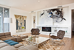 Modern living room with a large built in art installation. Interior designed by Andee Hess of Osmose.
