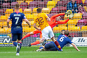 Jake Hastie (#35) of Motherwell FC scores the opening goal during the Ladbrokes Scottish Premiership match between Motherwell FC and Heart of Midlothian FC at Fir Park, Stadium, Motherwell, Scotland on 17 February 2019.