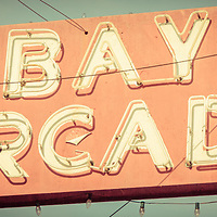 Newport Beach panoramic retro photo of the Bay Arcade sign. Panoramic photo ratio is 1:3 and has an old vintage retro tone. The Bay Arcade is located in the Balboa Fun Zone in Orange County Southern California.