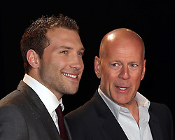 Jai Courtney and Bruce Willis at the A Good Day To Die Hard  premiere in London, Thursday, 7th February 2013. Photo by: Stephen Lock / i-Images