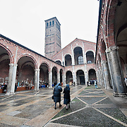 MILAN, ITALY - DECEMBER 07: Two nuns arrive early morning to Sant'Ambrogio for the celebration of the patron of Milan on December 7, 2010 in Milan, Italy. The skeleton of Saint Ambrogio lays with the remains of San Gervasio e San Protasio in the ancient basilica of Sant'Ambrogio in the city centre of Milan