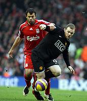 Photo: Mark Stephenson/Sportsbeat Images.<br /> Liverpool v Manchester United. The FA Barclays Premiership. 16/12/2007.Wayne Rooney holds off Jevier Mascherano