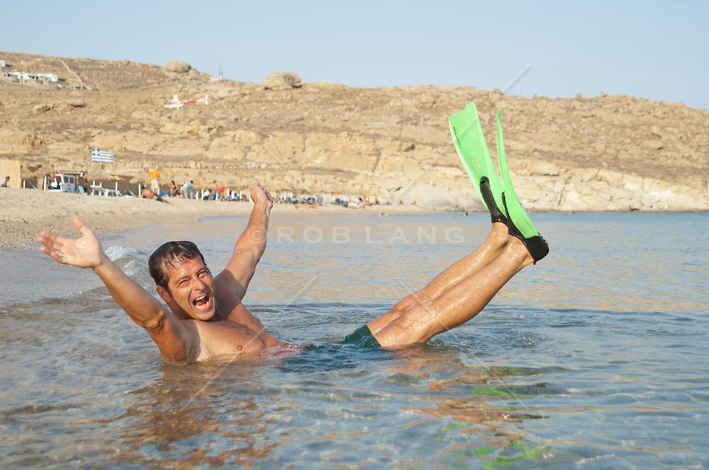 man having fun in the Aegean Sea in Greece