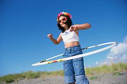 North America, United States, Washington, Long Beach, girl (age 10) doing hula hoop on beach