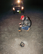 U.S. Forest Service biologist, Randy Griebel, checks a specially designed, circular PIT tag reader, during a Black-footed ferret population survey near Wall, South Dakota, USA.