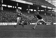 07/09/1975<br /> 09/07/1975<br /> 7 September 1975<br /> All-Ireland Hurling Final: Kilkenny v Galway at Croke Park, Dublin. <br /> Galway defender, Joe McDonagh (right), fails to stop Kilkennys captain, Billy Fitzpatrick, from hitting the ball.