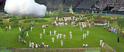 Green and Pleasant land depicting Great Britain before the industrial Revolution. A farm, Horse and carriage, Sheep, Geese, chicken where part of the cast. With tradionally on the village green a game of Cricket being played. Technical rehearsal of the openings ceremony of the Olympic Games in London.
