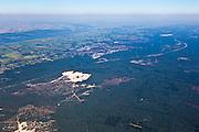 Nederland, Gelderland, Gemeente Nunspeet, 06-09-2010; noordelijk deel Gelderse Veluwe, gezien naar het Veluwemeer (onderdeel van de Randmeren). In de voorgrond Hulsthorsterheide en Hulsthorsterzand, de weg is de A28 en de bebouwing Nunspeet. The warme lucht boven het land laat inversie zien. .Northern Veluwe, seen to the 'border lakes' between the old and new land.luchtfoto (toeslag), aerial photo (additional fee required).foto/photo Siebe Swart