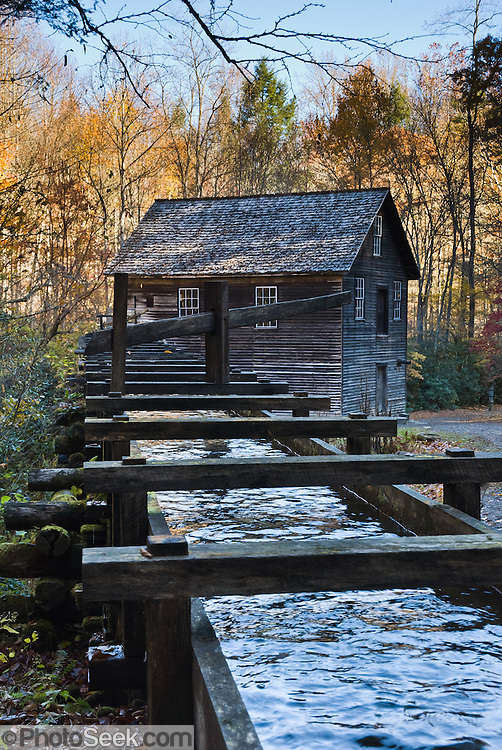 Mingus Mill is a half-mile north of the Oconaluftee Visitor Center in Great Smoky Mountains National Park on Newfound Gap Road, on the North Carolina side. Built in 1886 on its present site, this historic grist mill uses a water-powered turbine instead of a water wheel to power all of the machinery in the building. Water flows down a millrace to a working cast iron turbine in the mill. A miller demonstrates the process of grinding corn into cornmeal, available for purchase at the mill.