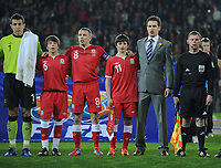 Football - International Friendly Gary Speed Memorial Match - Wales vs. Costa Rica<br /> Injured Wales captain Aaron Ramsey, stand in captain Craig Bellamy and Gary Speed's sons Ed and Tommy during the Welsh national anthem at the Cardiff City Stadium