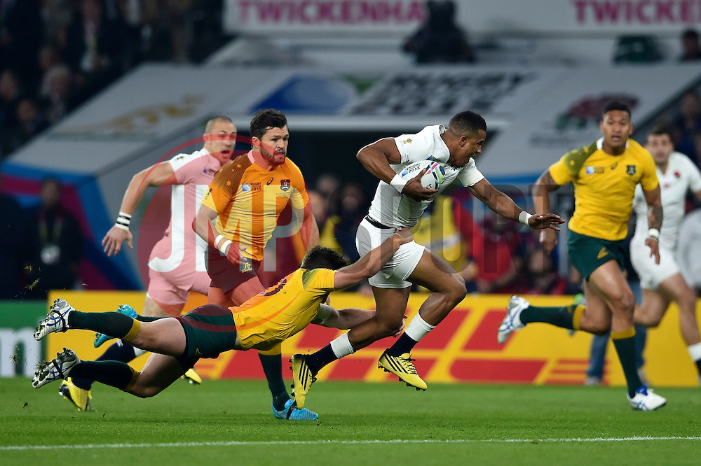 Anthony Watson of England takes on the Australia defence - Mandatory byline: Patrick Khachfe/JMP - 07966 386802 - 03/10/2015 - RUGBY UNION - Twickenham Stadium - London, England - England v Australia - Rugby World Cup 2015 Pool A.