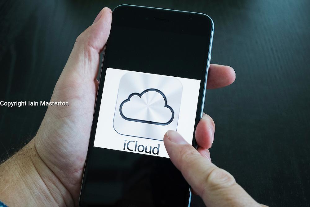 Apple iCloud online cloud storage logo on screen of iPhone 6 Plus smart phone