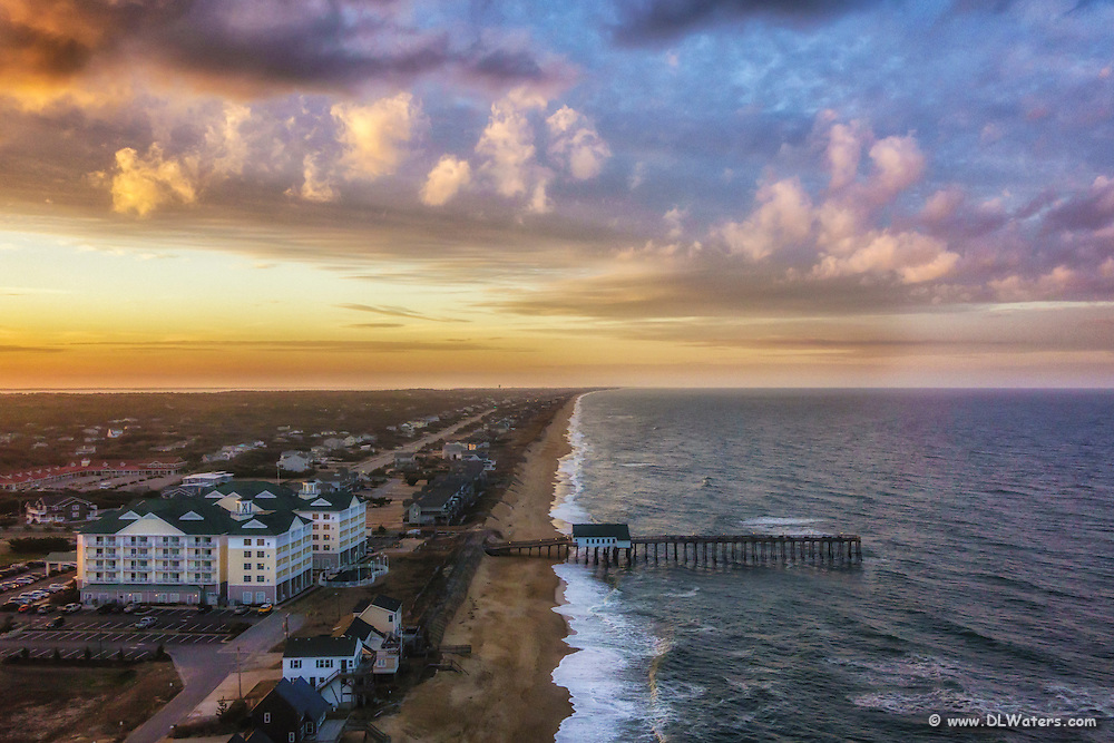 Aerial photograph of Kitty Hawk fishing pier at sunset.