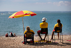 © Licensed to London News Pictures. 23/08/2019. Portsmouth, UK. Lifeguards keep watch over the beach at Southsea, Portsmouth enjoy the sunshine. Record high temperatures are expected in parts of the United Kingdom over the three day bank holiday weekend. Photo credit: Peter Macdiarmid/LNP