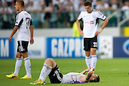 (C) Legia's Marek Saganowski lies on the pitch after the UEFA Champions League play-off second leg match between Legia Warsaw and FC Steaua Bucuresti at Pepsi Arena Stadium in Warsaw on August 27, 2013.<br /> <br /> Poland, Warsaw, August 27, 2013<br /> <br /> Picture also available in RAW (NEF) or TIFF format on special request.<br /> <br /> For editorial use only. Any commercial or promotional use requires permission.<br /> <br /> Photo by © Adam Nurkiewicz / Mediasport