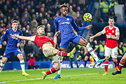 Arsenal defender Shkodran Mustafi (20) clears the ball away from Chelsea forward Tammy Abraham (9) during the Premier League match between Chelsea and Arsenal at Stamford Bridge, London, England on 21 January 2020.