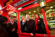 2/2/2011.Labour leader Eamon Gilmore pictured in the window of Dores on Kierans Street on the campaign trail in Kilkenny yesterday with Carlow Kilkenny candidates  Cllr Ann Phelan (right) and Cllr Des Hurley (left shoulder)..Picture Dylan Vaughan....