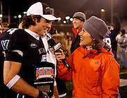 CHATTANOOGA, TN - DECEMBER 18:  Wide receiver Matt Szczur #4 of the Villanova Wildcats is interviewed by ESPN sideline reporter Cara Capuano after the game against the Montana Grizzlies at Finley Stadium on December 18, 2009 in Chattanooga, Tennessee.  Szczur was named the FCS Championship Most Outstanding Player and the Wildcats beat the Grizzlies 23-21.  (Photo by Mike Zarrilli/Getty Images)