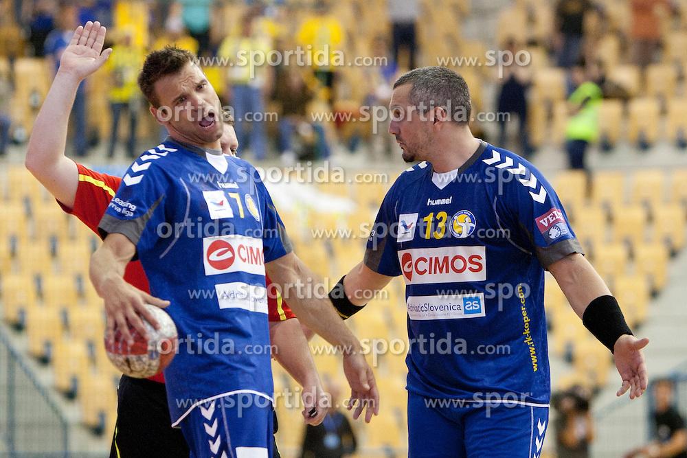 Matjaz Brumen and Milorad Krivokapic of Cimos during handball match between RK Celje Pivovarna Lasko vs RK Cimos Koper in 9th Round of 1st NLB Leasing Champions league 2011/12, on May 19, 2012 in Arena Zlatorog, Celje, Slovenia. (Photo by Urban Urbanc / Sportida.com)