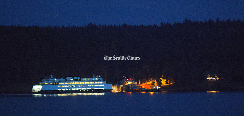 A Washington State Ferry approaches the Shaw Island terminal in a chilly autumn dusk. (Mike Siegel/The Seattle Times)