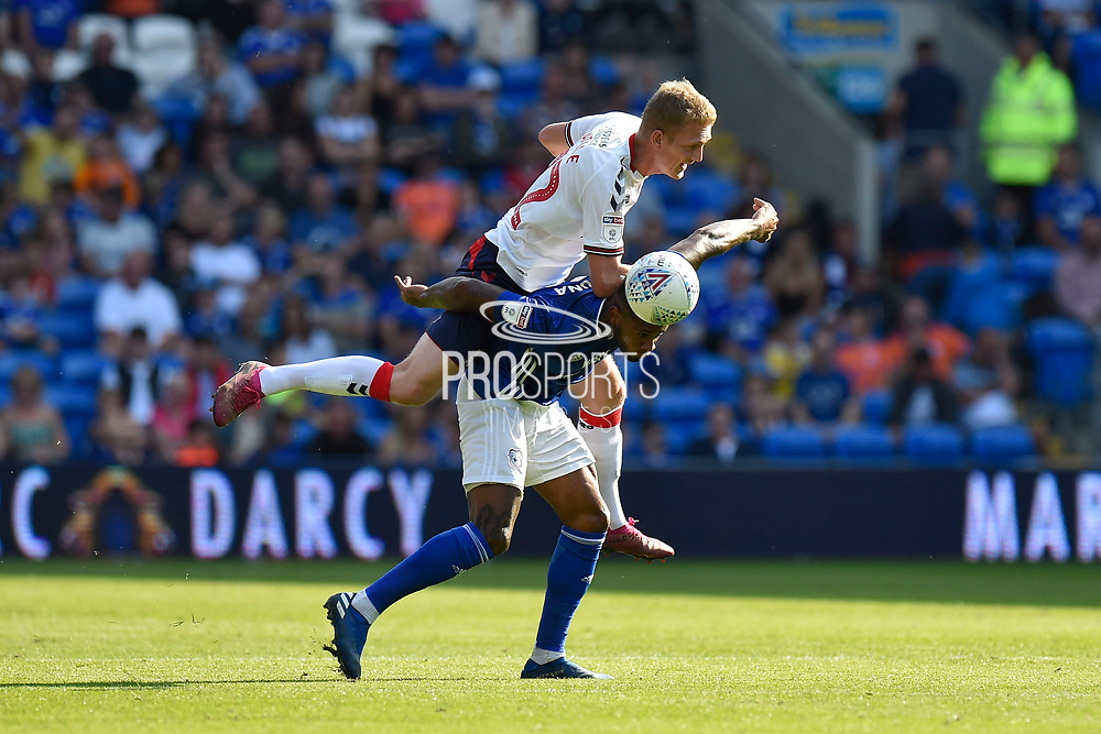 George Saville (22) of Middlesbrough fouls Leandro Bacuna (7) of Cardiff City during the EFL Sky Bet Championship match between Cardiff City and Middlesbrough at the Cardiff City Stadium, Cardiff, Wales on 21 September 2019.