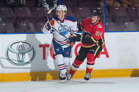 PENTICTON, CANADA - SEPTEMBER 8: Rasmus Andersson #54 of Calgary Flames checks a player of the Edmonton Oilers during first period on September 8, 2017 at the South Okanagan Event Centre in Penticton, British Columbia, Canada.  (Photo by Marissa Baecker/Shoot the Breeze)  *** Local Caption ***