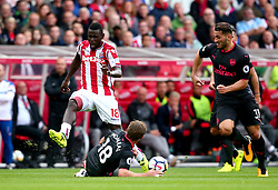 Mame Biram Diouf of Stoke City is tackled by Nacho Monreal of Arsenal - Mandatory by-line: Robbie Stephenson/JMP - 19/08/2017 - FOOTBALL - Bet365 Stadium - Stoke-on-Trent, England - Stoke City v Arsenal - Premier League