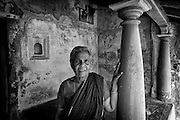 Many homes in South India have a platform at the entrance called a 'thinnai'. A place for visitors and home owners to sit. Pillar on facade of old house. Tarangambadi.<br /> Tamil Nadu. South India.