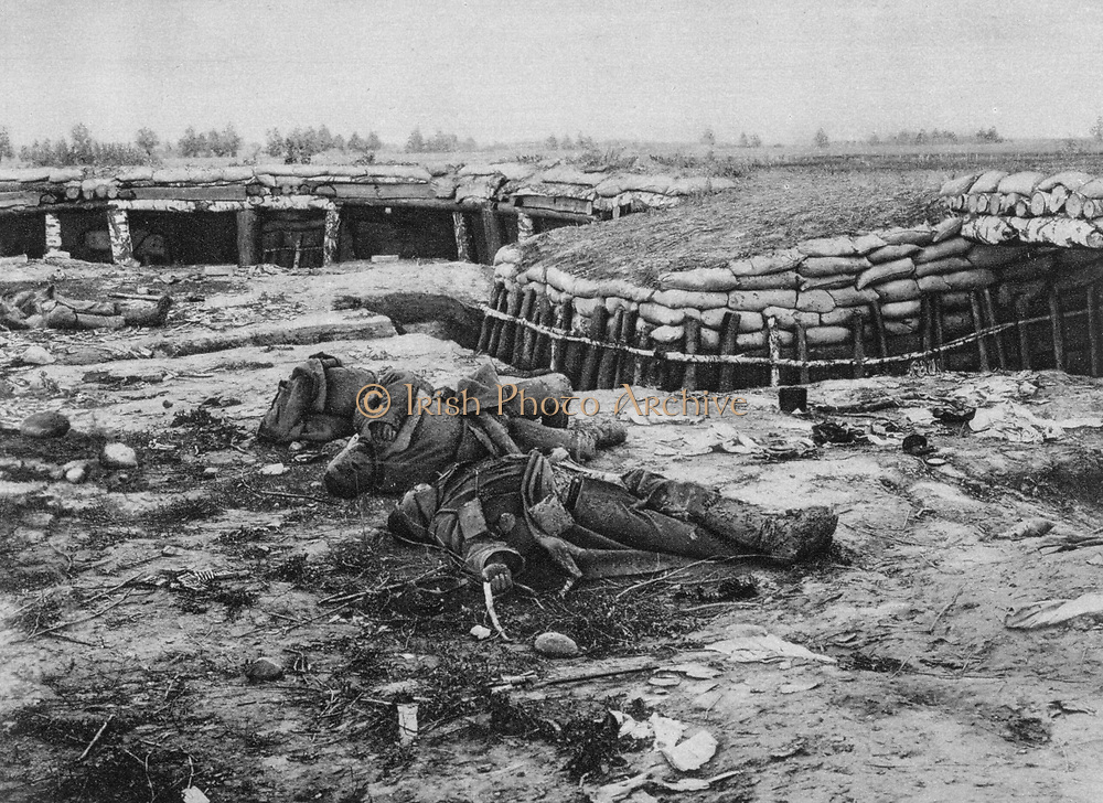 World War I 1914-1918: Eastern Front. Russian position abandoned in the face of German advance through Poland, 20 July/ 2 August) 1915. Battlefield Trench Soldier Dead Body