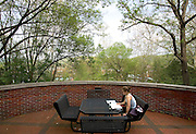 Alex Burnett-Greenstein studies among the trees behind her dorm, Bryan Hall on Wednesday, 5/2/07.