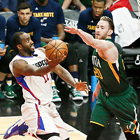 25 April 2017: LA Clippers forward Luc Mbah a Moute (12) goes for the layup against Utah Jazz center Rudy Gobert (27) during the Utah Jazz 96-92 victory over the Los Angeles Clippers, during game 5 of the first round of the Western Conference playoffs, at the Staples Center, Los Angeles, California, USA.