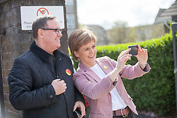 First Minister of Scotland and leader of the SNP Nicola Sturgeon, out on the election trail to make sure people are out voting today, May 7, 2015 in Glasgow, Scotland. With William Haughey in the Gorbals.