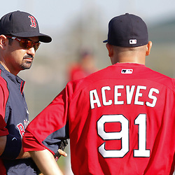 February 19, 2011; Fort Myers, FL, USA; Boston Red Sox first baseman Adrian Gonzalez (left) talks with relief pitcher Alfredo Aceves (91) during spring training at the Player Development Complex.  Mandatory Credit: Derick E. Hingle