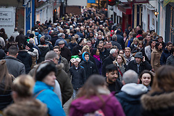 "© Licensed to London News Pictures. 3/12/2016. Lincoln, UK. Thousands of people descended upon Lincoln over the weekend to start their Christmas shopping and visit the annual Christmas market. With over 200 stalls surrounding the Cathedral and Castle in the uphill area a one way system to control visitors had to be put in place due to the huge crowds thronging the City Centre. Picture shows shoppers making their way up ""The Strait"". Photo credit: Dave Warren/LNP"
